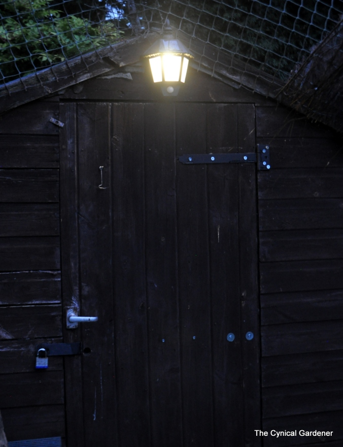 Black Outdoor Solar Security Welcome Wall Light with PIR.