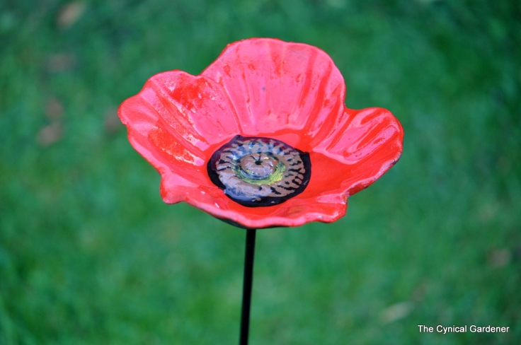 Heavy metal Poppy design seed feeder or water dish.